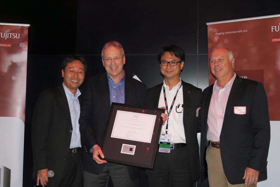 Peter accepting an award from Fujitsu at Oracle OpenWorld 2015